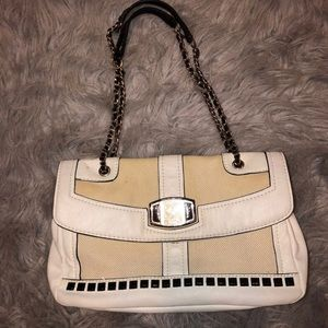 Over the shoulder GUESS purse.